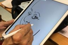 caricature sur ipad avec stylet